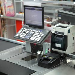 Автоматический детектор Moniron Dec POS на кассе супермаркета